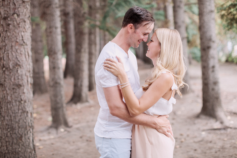 Sunset Engagement in Calgary, forest, couple kissing by calgary photographer nicole sarah