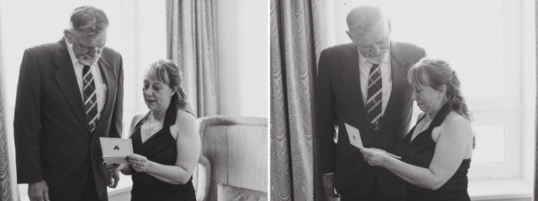 groom's parents reading a letter at fairmont banff springs hotel from nicole sarah, wedding photographer in calgary