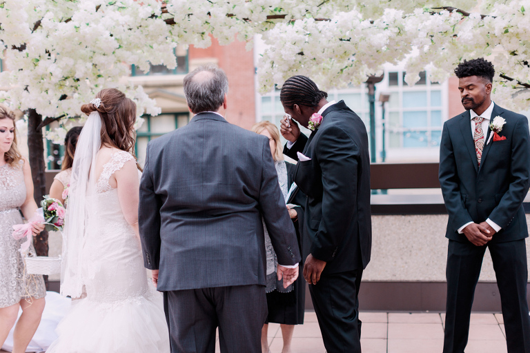 rooftop wedding, cherry blossoms, urban wedding photos, calgary wedding photographers, downtown wedding, groom crying, groom reaction