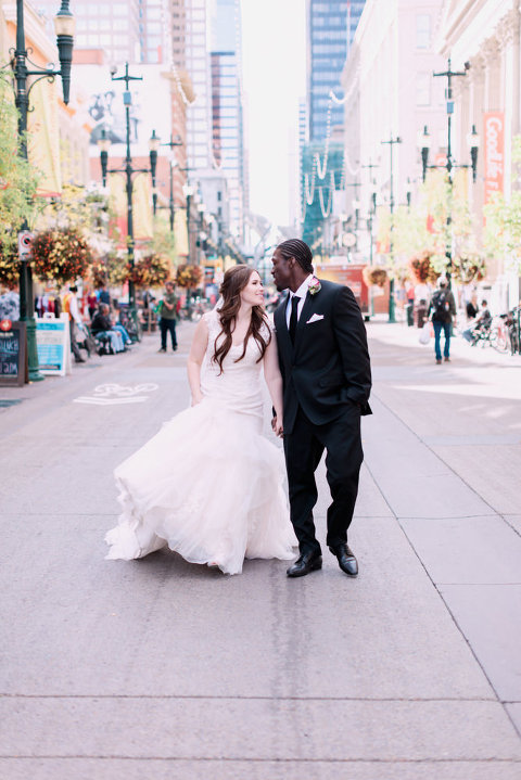 rooftop wedding, cherry blossoms, urban wedding photos, calgary wedding photographers, bride groom walking