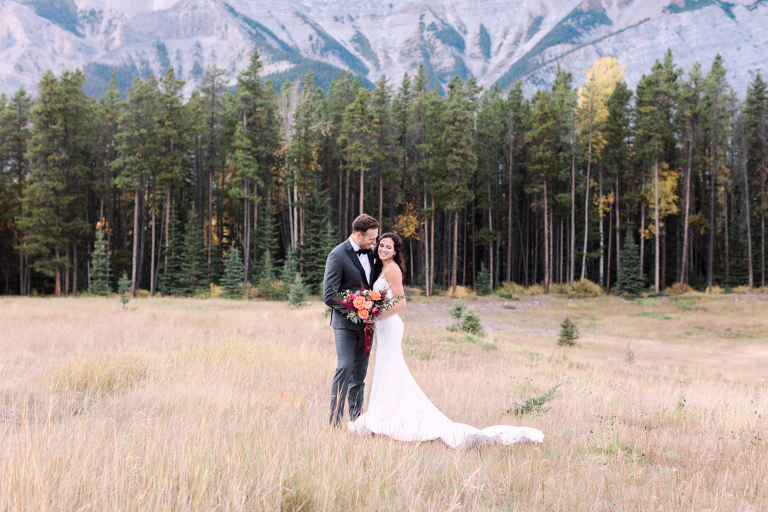 bride groom portrait, sunset photo, bridal bouquet, nicole sarah, calgary wedding photographers, mountains, banff, forest, pronovias