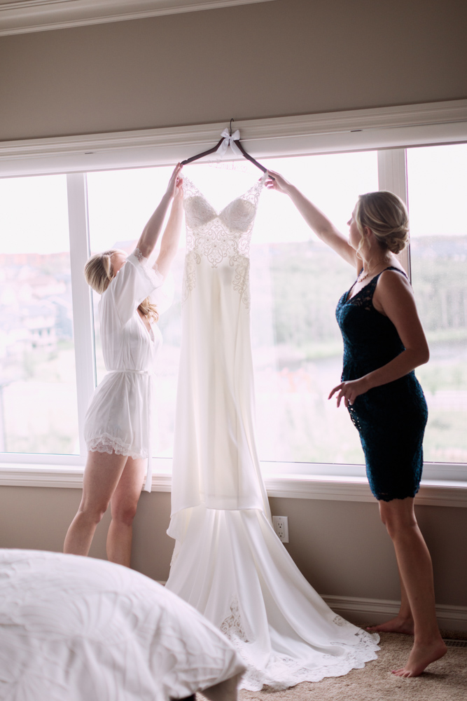 Getting Ready Wedding Photography Ideas, wedding dress, getting ready, candids, candid photography by calgary wedding photographers nicole sarah, flowers, bridesmaids, parents,