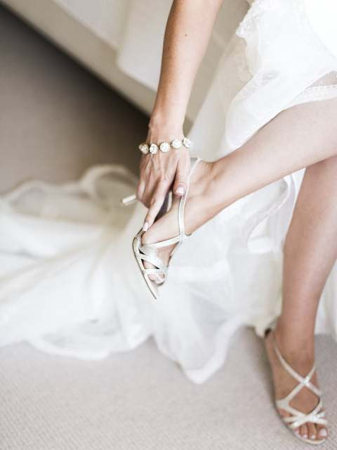 bridal shoes, bridal candid photos, bride getting ready, wedding shoes, wedding heels, calgary wedding photographers nicole sarah