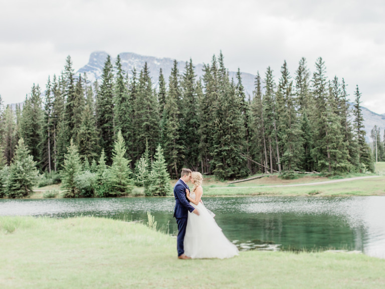 canmore wedding photographer, banff wedding photographer, calgary wedding photographer, crop top wedding dress, mountain wedding, film wedding, outdoor mountain wedding ceremony, large flower bouquet, navy groom suit, sage bridesmaid gowns, groom crying, bridesmaids laughing, bridesmaid inspiration, powder blue bridesmaid gown, two piece bride gown, tulle skirt, watters skirt, theia skirt, beaded crop top, summer wedding, mountainscape wedding, romantic rocky mountain wedding, love in the rockies