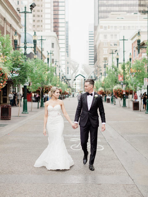 trumpet wedding gown, bride groom downtown, city bride walking, walking in the rain wedding, kissing in the rain wedding, bridal romantic updo, romantic updo, getting ready, see through wedding dress, wedding gown inspiration, custom wedding gown, calgary wedding photographers, calgary wedding photographer, ivy wall, film wedding photography, bride and groom wedding poses, wedding portrait ideas, unique wedding portraits, best calgary wedding photographers, cowboys calgary, dave urner, fall for florals, louboutin wedding shoes, wedding shoe inspo, wedding shoe inspiration, black bridesmaid gowns, bridesmaid black dresses, wedding posing ideas, wedding posing inspiration, soft romantic wedding portraits, film photographer calgary, fine art wedding photography