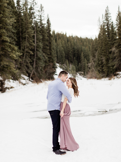 calgary wedding photographers, engagement session, winter engagement session, winter engagement, tulle dress engagement, christmas engagement, winter wedding, lace crop top tulle skirt, couple poses engagement, engagements calgary, christmas couple photos, wedding photography posing, photography posing ideas