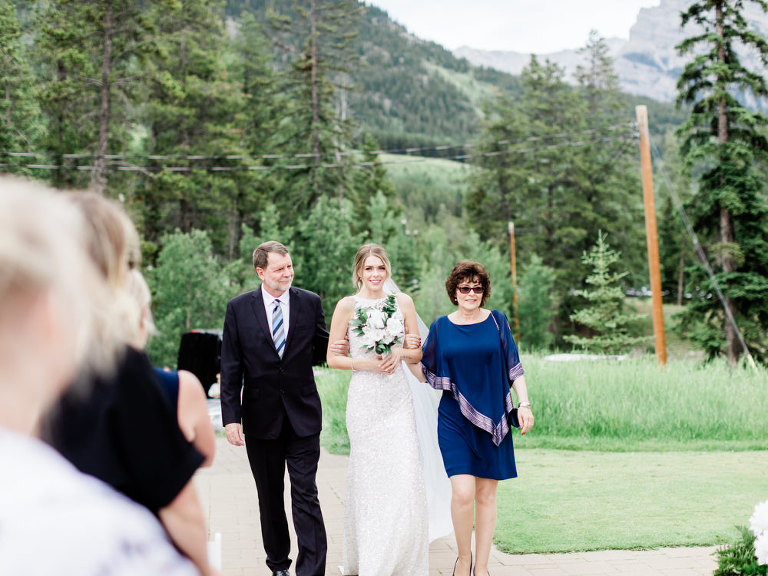 calgary wedding photographers, mountain wedding, bridal portraits, sequin wedding dress, emerald wedding, navy suit groom, groom style, long veil photos, silvertip canmore, silvertip resort wedding, rolls royce vintage, rolls royce wedding, gazebo wedding, bride groom poses, french bulldog wedding, frenchie wedding, low cut sequin dress, couple poses, sunset wedding photos, nicole sarah photography, calgary photographers