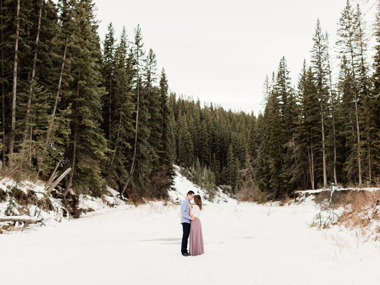 Calgary Wedding Photographer Winter Engagement, winter engagement session, winter engagement style, winter engagement wardrobe, wardrobe style, winter engagement posing, lace top engagement, flowy skirt, pink skirt engagement